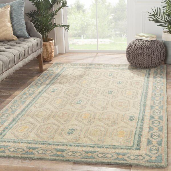 Caesars Hand-Tufted Ivory/Blue Area Rug by Loon Peak