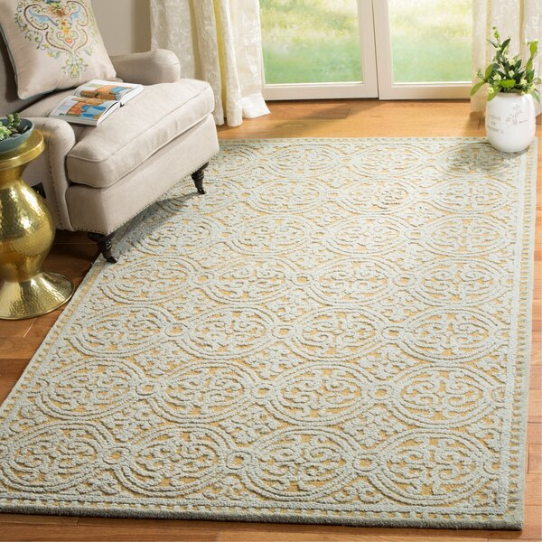 Charlenne Hand-Tufted Blue/Gold Area Rug by Zipcode Design