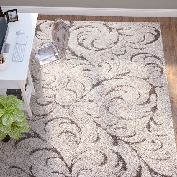 Goldsmith Traditional Ivory Area Rug by Three Posts