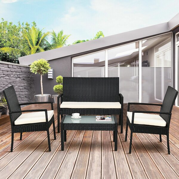 Caldwell Outdoor 4 Piece Rattan Sofa Seating Group with Cushions by Wrought Studio