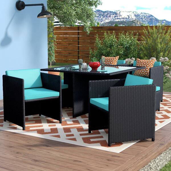 Travers Reverse 9 Piece Outdoor Patio Dining Set with Cushions by Latitude Run