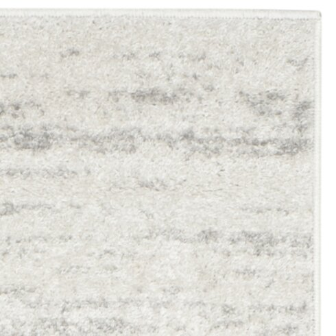 Busick Ivory Silver Area Rug