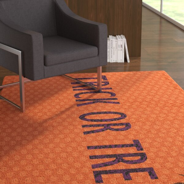 Adriel Trick or Treat Orange Area Rug by The Holiday Aisle
