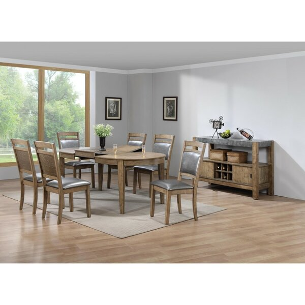 Hubble Sprucely Trimmed Solid Wood Dining Table by August Grove