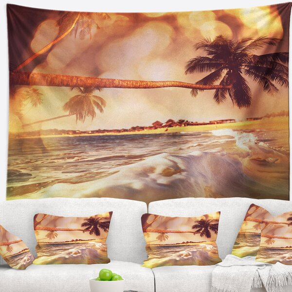 Tropical Beach with Bent Coconut Palms Tapestry by East Urban Home