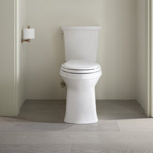 Corbelle Comfort Height® Two-Piece Elongated 1.28 GPF Toilet with Skirted Trapway and Revolution 360™ Swirl Flushing Technology and Left-Hand Trip Lever By Kohler