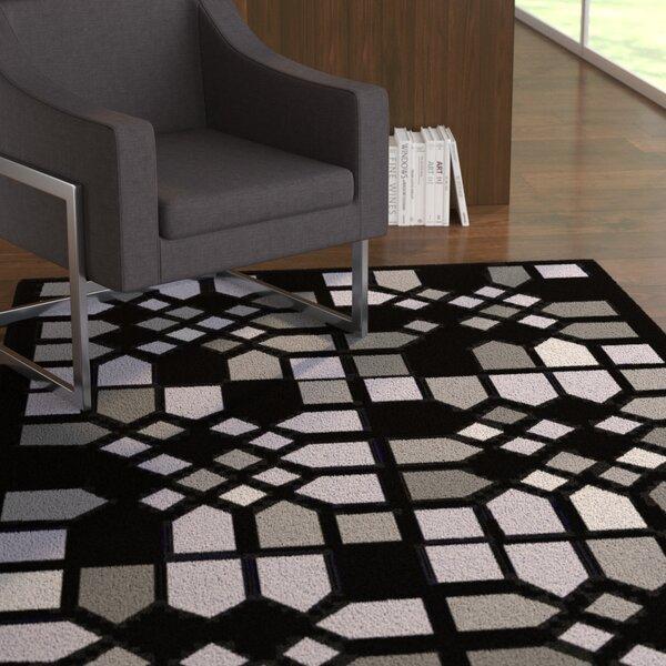 Abrielle Black Geometric Area Rug by Latitude Run