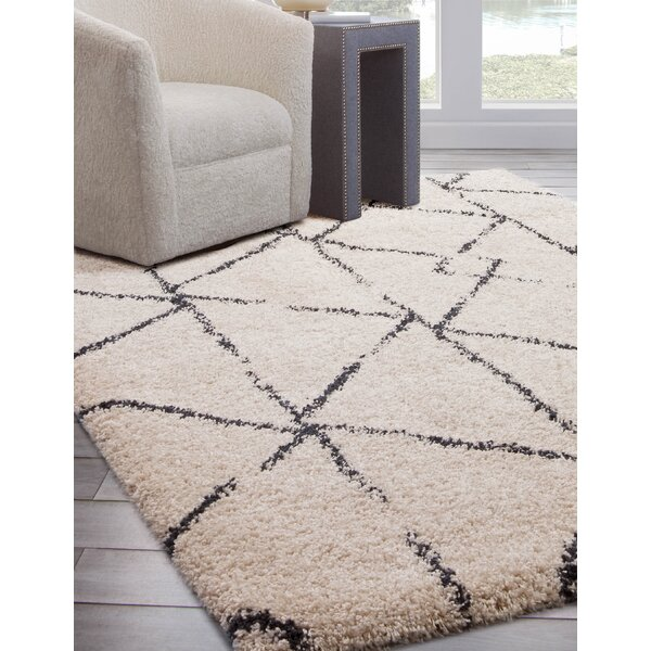 Wiegand Ivory/Black Area Rug by Orren Ellis
