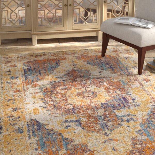 Almendarez Distressed Gold/Orange Area Rug by Bungalow Rose