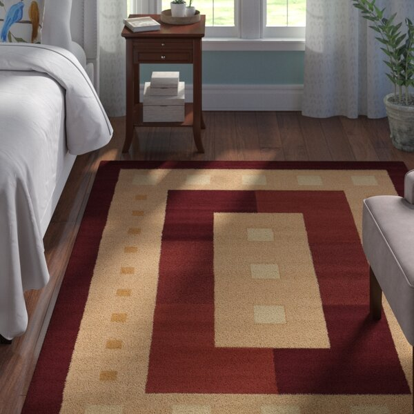 Finnegan Times Square Burgundy Area Rug by Andover Mills