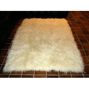 Order Hera Flokati Extra Natural White Solid Area Rug By IXI