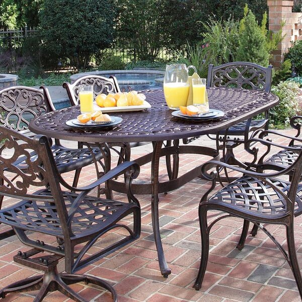 Van Glider Oval Outdoor Dining Table by Astoria Grand