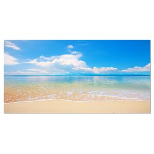 'Large Clouds Over Calm Beach' Photographic Print on Wrapped Canvas by Design Art