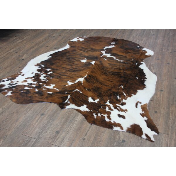 Thurso Hand-Woven Cowhide Brown Area Rug by Loon Peak