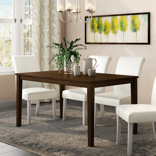 Rhem Solid Wood Dining Table by Charlton Home