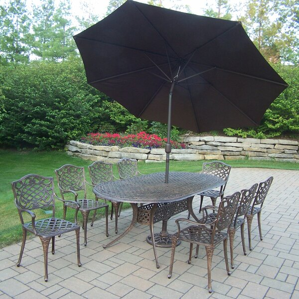 Mcgrady 9 Piece Dining Set with Umbrella by Astoria Grand