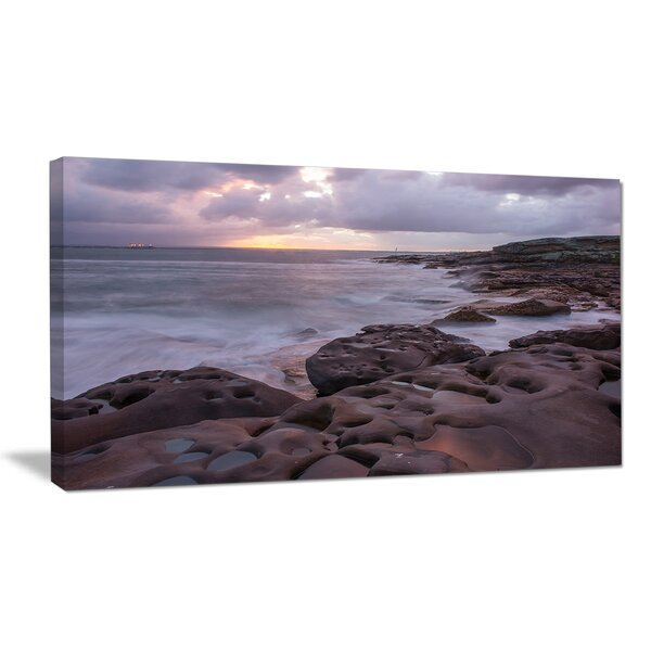 Dark Australian Seashore with Large Rocks Large Seashore Photographic Print on Wrapped Canvas by Design Art