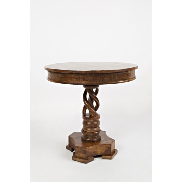 Goodridge Hand Carved Round Solid Wood Dining Table by Astoria Grand