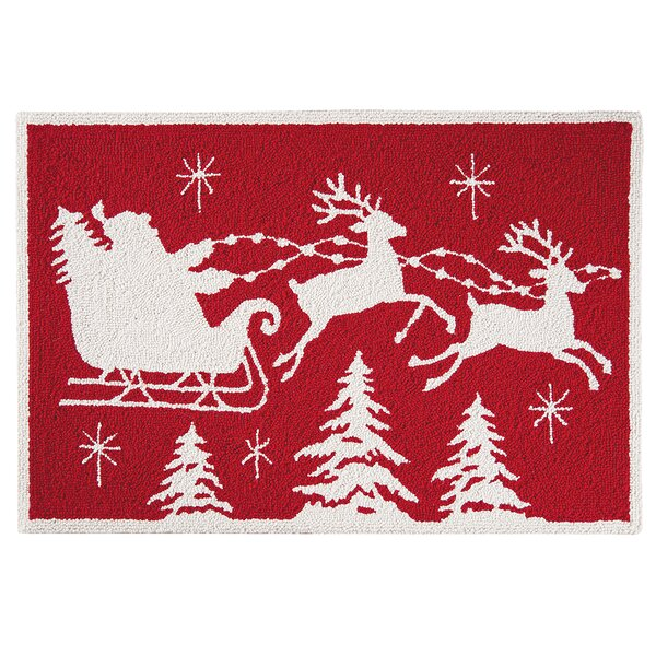 Flying Sleigh Christmas Wool Red Area Rug by The H