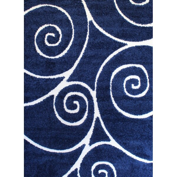 Quaoar Shaggy Swirls Navy Blue Area Rug by Wrought Studio
