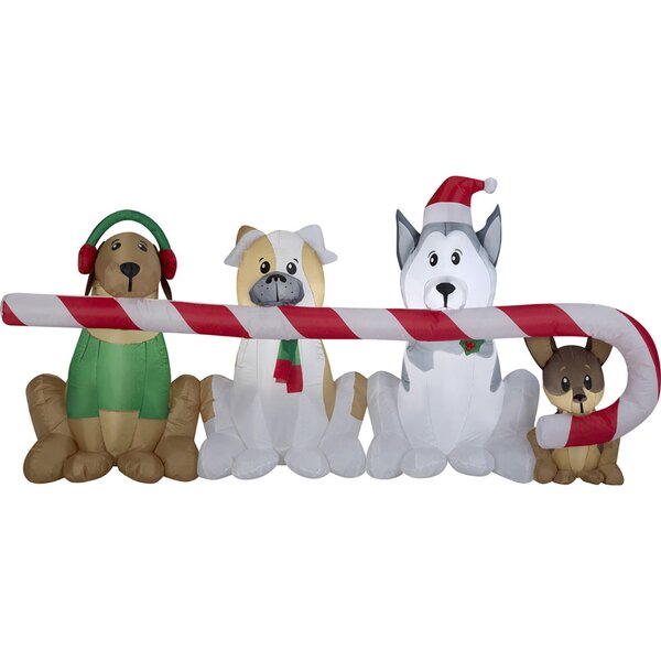 Airblown Puppies Sharing a Big Candy Cane Scene In