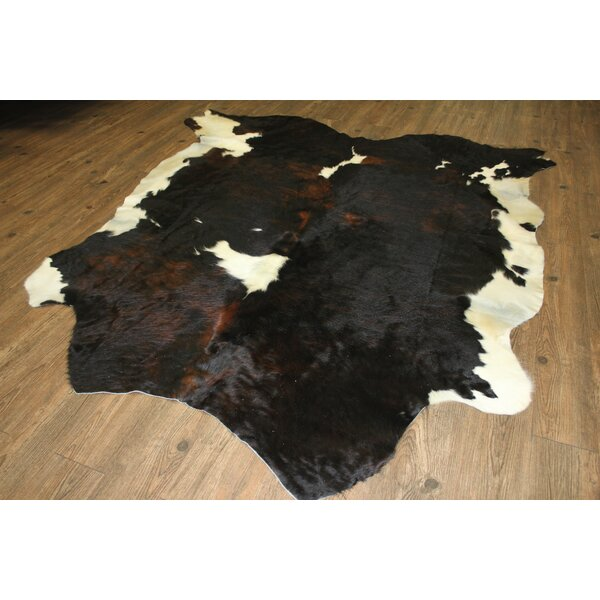 Thalia Hand-Woven Cowhide Brown/Black Area Rug by Loon Peak