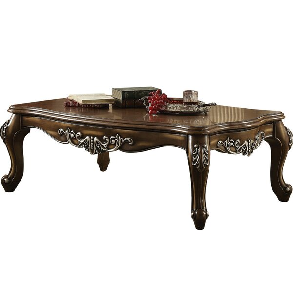 Jayla Intricately Carved Wooden Coffee Table by Astoria Grand