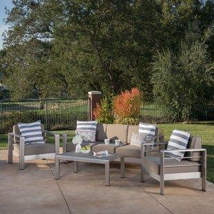 https://secure.img1-ag.wfcdn.com/im/57582323/resize-h310-w310%5Ecompr-r85/4951/49517998/villegas-4-piece-sofa-set-with-cushions.jpg