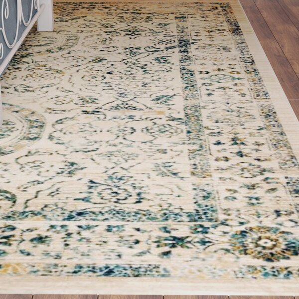 Ruthie Beige/Turquoise Area Rug by August Grove