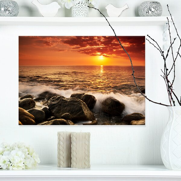 Bright Sunset over Rocky Shore Photographic Print on Wrapped Canvas by Design Art