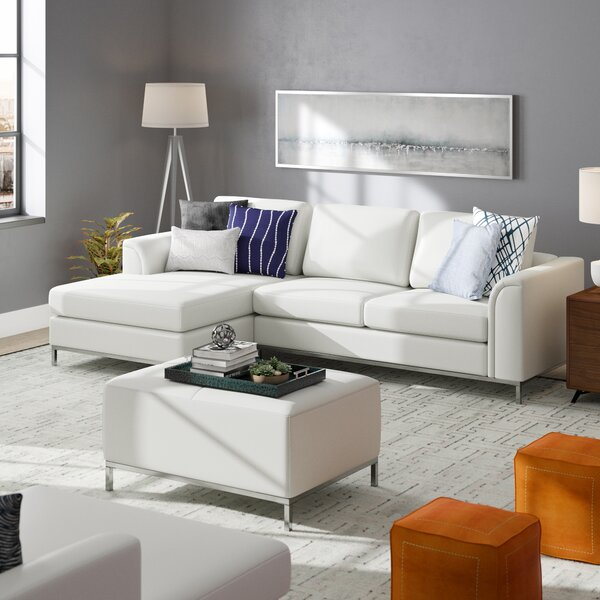 Catlett Leather Reversible Sectional with Ottoman by Wade Logan