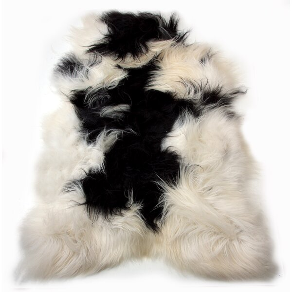 Emalie Long-Haired Hand-Woven Sheepskin Black/White Area Rug by House of Hampton