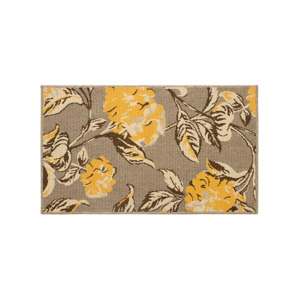 Jaya Hydrangea Yellow/Beige Indoor/Outdoor Area Rug by Laura Ashley