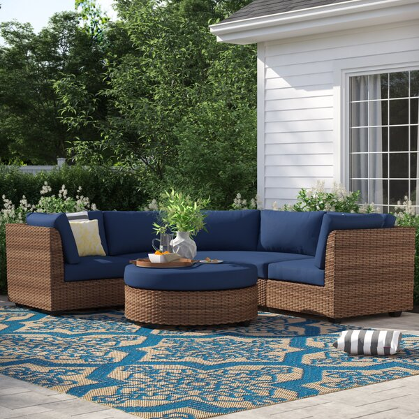 Waterbury 4 Piece Rattan Sectional Seating Group with Cushions