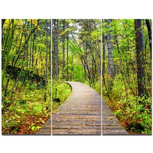 'Wooden Boardwalk across Forest' Photographic Print Multi-Piece Image on Canvas by Design Art