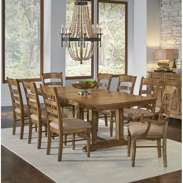 Ian 9 Piece Extendable Solid Wood Dining Set by One Allium Way