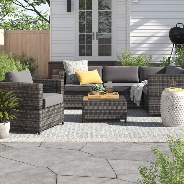 Devante 4 Piece Rattan Sectional Seating Group Set with Cushions by Zipcode Design