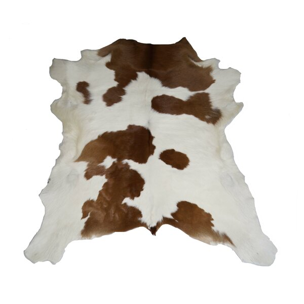 Flore Designer Cowhides Brown and White Calf Skin Area Rug by Loon Peak