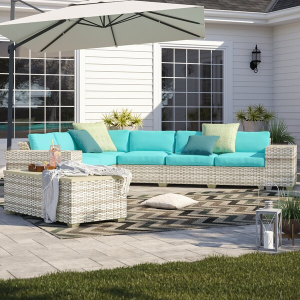 Falmouth 9 Piece Rattan Sectional Seating Group with Cushions