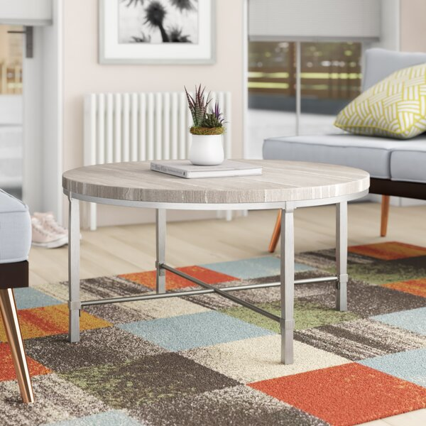 Alexys Round Coffee Table by Orren Ellis