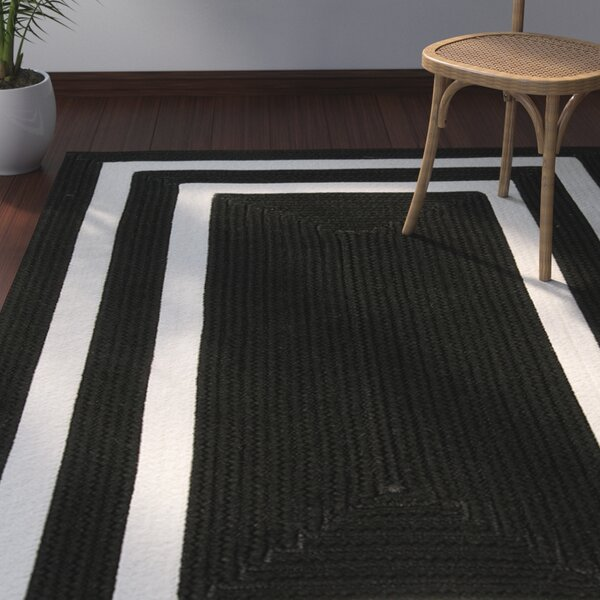 Marti Hand-Woven Outdoor Black Area Rug by Bay Isle Home