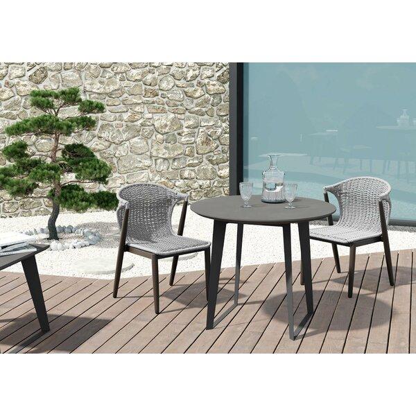 Salaam Stone/Concrete Coffee Table by Orren Ellis