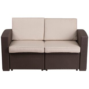 Clifford Faux Rattan Loveseat with Cushion by Breakwater Bay