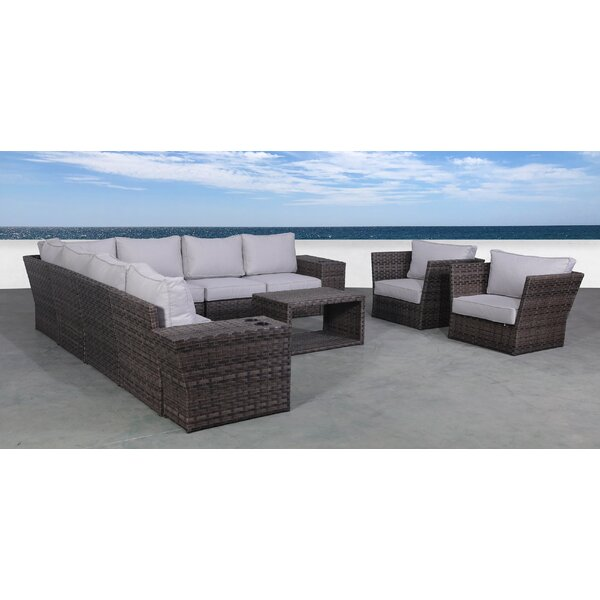 Ryne 12 Piece Rattan Sectional Seating Group with Cushions by Highland Dunes
