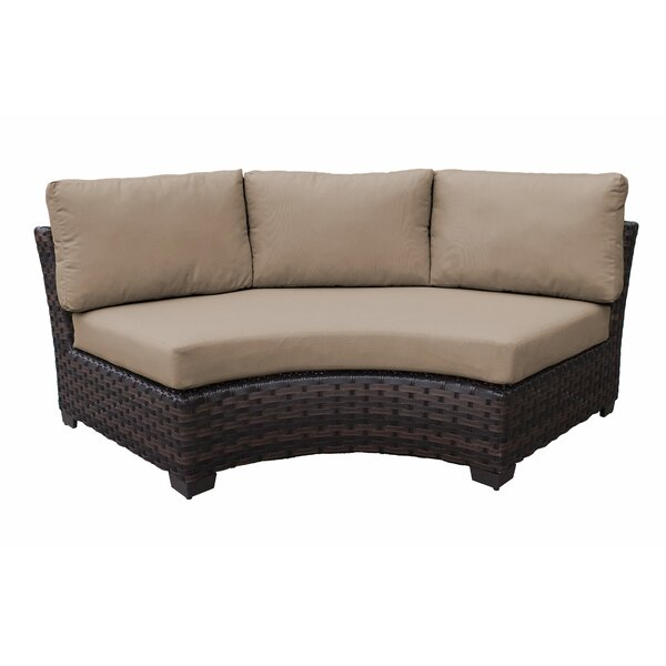 kathy ireland Homes & Gardens River Brook Curved Patio Chair with Cushions by kathy ireland Homes & Gardens by TK Classics kathy ireland Homes & Gardens by TK Classics