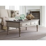 Ismael Coffee Table with Storage by Ophelia & Co.