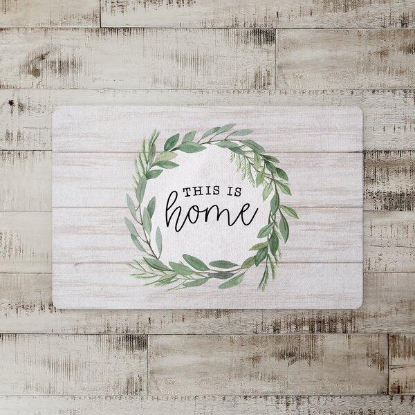 Sezis Home Wreath on Wood Kitchen Mat
