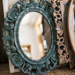 World Menagerie Summit Carving Frame Accent Mirror