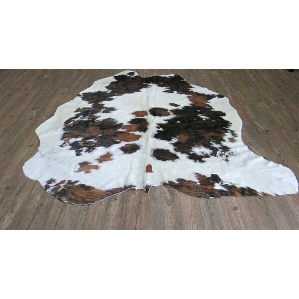 Verlaine Hand-Woven Cowhide White/Black Area Rug by Loon Peak