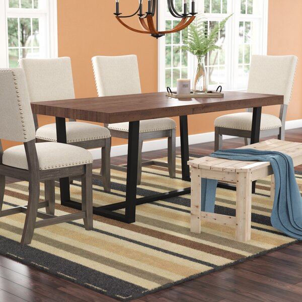 Neely Distressed Solid Wood Dining Table by Union Rustic